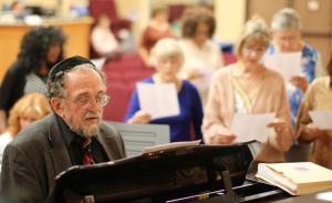 Rabbi Stuart Dauermann playing the piano