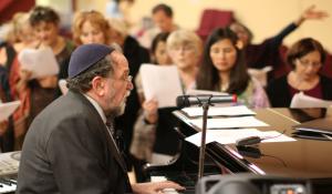 Dr. Stuart Dauermann playing piano